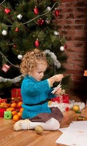 11506937-little-girl-near-christmas-tree.jpg